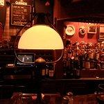 Low lit lamps across the bar area