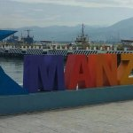Manzanillo sign in front of the sea port