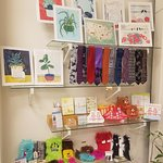 The feature wall is often reserved for monthly pop-ups or other fun goodies by our artists!