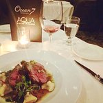 Evening dinner of Herb Crusted Lamb Sirloin and a 40 Knots Rose.