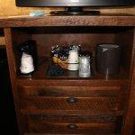 coffee maker next to mini frigerator