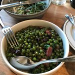Peas with bacon (eggplant in background)