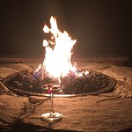 Fire pit with a glass of local wine - perfect way to end a busy day!