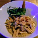 Pasta with chicken, shrimps and vegetables in tucupi sauce