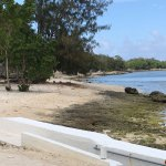 This is low tide but there is easy access for swimming through the ocean pool to the coral.