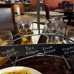 Flight of beers. Names written in chalk. How clever!