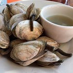 Bowl of steamed clams with broth and drawn butter