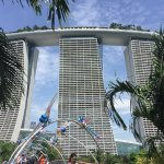 view from Gardens by the Bay, of Dragon Fly bridge and Marina Sands Hotel