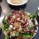 Macaroni and cheese along with beet salad with mixed greens