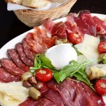 Enjoy our antipasti plate of Italian cured meats and cheese.