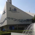 Front view of Aquarium (in background lower part of Pearl Tower) -