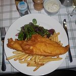 Massive portion of Haddock, Chips and Tartare sauce. Delicious!