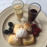 The beignets are fantastic for dessert that are served with Jam and vanilla glaze.