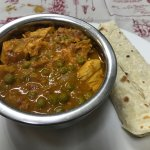 Chicken curry served with roti at The Posthouse Restaurant