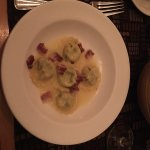 Ravioli of dandelion greens and ricotta cheese with pancetta