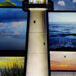 Gorgeous, lit pictures of the gulf and the lighthouse.