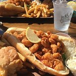 Shrimp po' boy with fries, sweet potato biscuit, and coleslaw