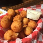 Complimentary hushpuppies with honey butter