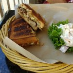 Grilled cheese with Kalua pork, carmelized onion, apple slices & potato-pasta salad