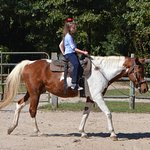 Gracie loves to ride! Remington is a great horse!