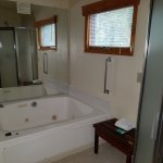 Partial view of master bath with whirlpool and shower--also had sink, hairdryer, toilet, etc.