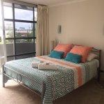 bedroom with back balcony
