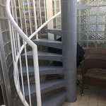 Spiral staircase leads up to the roof entertainment/relaxation area.