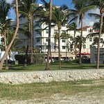 Front of Hotel from across street at beach path.