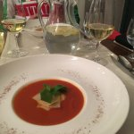 Soup made of baked tomatoes, sundry tomatos, homemade basil pesto and ripened cheese