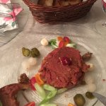 Tartar of beef sirloin decorated with poppy mustard and onion