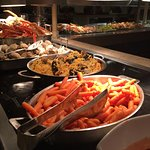 Buffet bar with seafood paella and snow crabs