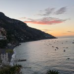Sunrise from our balcony. Positano beach at the bottom left