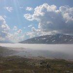 Foggy lake on a mountain pass