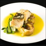 Bacalhau à Lagareiro. Grilled Dried Codfish with Roast Potatoes and Turnip Tops, Olive Oil and G