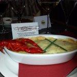 Cassolette de scampis au petits légumes et au champagne