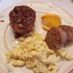 Sticky bun, eggs and local sausage