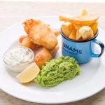 Battered fish bites, crushed peas, ravigote sauce, beef dripping chips