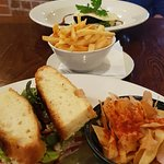 Ham sandwich foreground, blackpud & colcannon plus fries to share