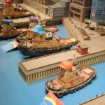 Model of Halifax harbor with Theodore the tugboat models