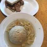 Matzo ball soup with noodles and 1/2 pastrami sandwich