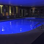 Indoor heated pool at night time