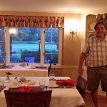 Host Peter Starbuck in dining room with view of the back lawn