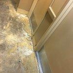 Lovely room entrance, no carpet, mold, rests of concrete