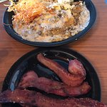 omelet with sausage and sausage gravy and hash browns