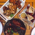 Top: Portuguese Chicken; Right: Root Vegetable Crisps; Bottom: Pork Short Rib