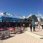 صورة فوتوغرافية لـ Boardwalk Amusement Area and Pier