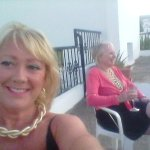 Share drinks and company on roof terrace....
