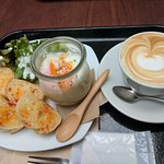 Mashed potatoes with soft egg and cappuccino