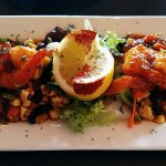 New Orleans BBQ Shrimp sautéed gulf shrimp tossed with house made sweet and spicy BBQ sauce serv