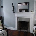 non functional fireplace in Grey room.